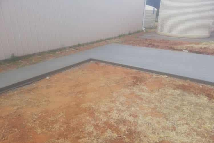 An image of a concrete path surrounded by dirt in the backyard of a Ballarat home