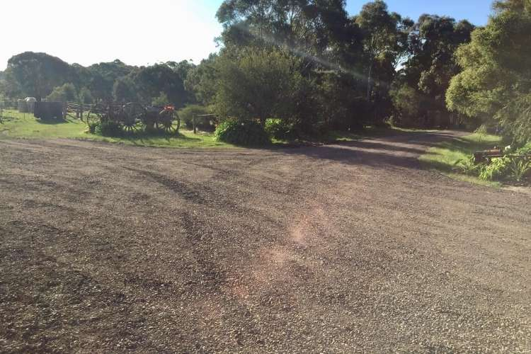 An image of a crushed rock driveway in a Ballarat home surrounded by grass, trees and a clear blue sky