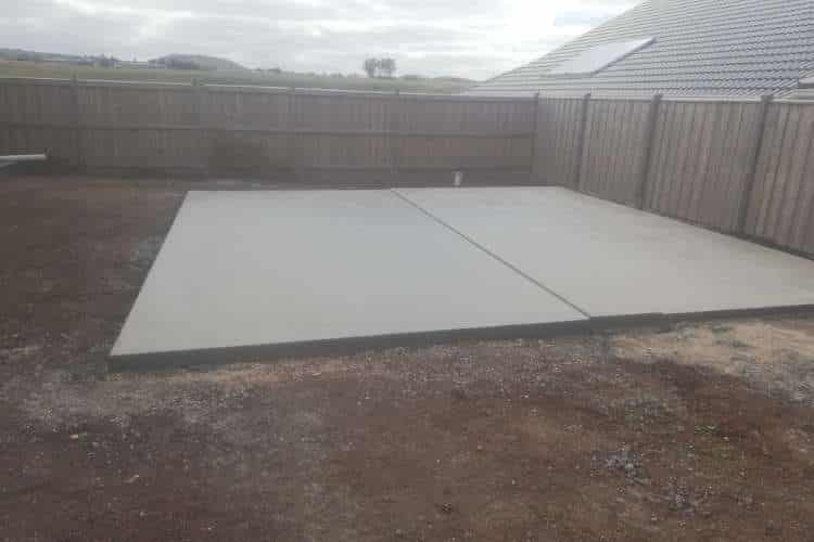 An image of a concrete slab laid in a Ballarat homes backyard, ready for a shed or garage to be built on top